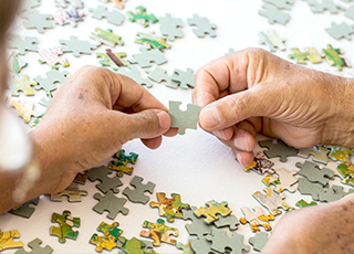 Couple putting together a puzzle